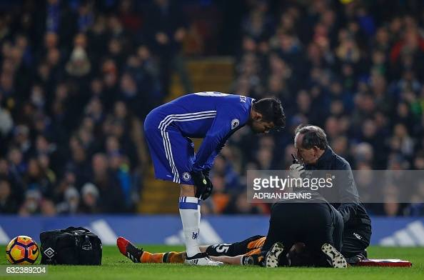 Hull City's English midfielder Ryan Mason receives medical treatment after a clash of heads as Chelsea's Brazilianborn Spanish striker Diego Costa...