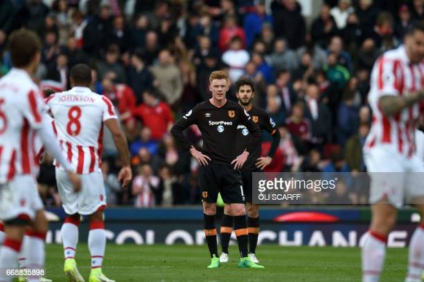 Hull City's English midfielder Sam Clucas and Hull City's Italian defender Andrea Ranocchia react to conceding Stoke City's third goal during the...