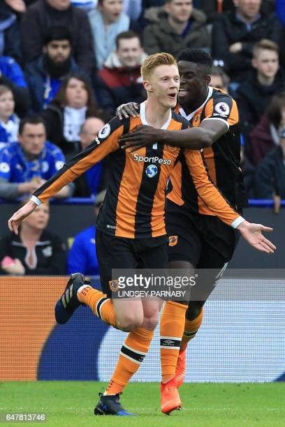 Hull City's English midfielder Sam Clucas celebrates with Hull City's French midfielder Alfred N'Diaye after scoring the opening goal of the English...