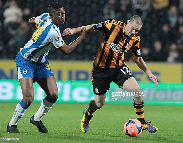 Hull City's English striker Matt Fryatt is tackled by Brighton and Hove Albion's English defender Rohan Ince during the English FA cup 5th round...