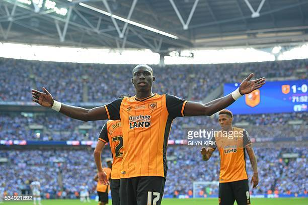 Hull City's Frenchborn Senegalese midfielder Mohamed Diame celebrates scoring the opening goal during the English Championship playoff final football...