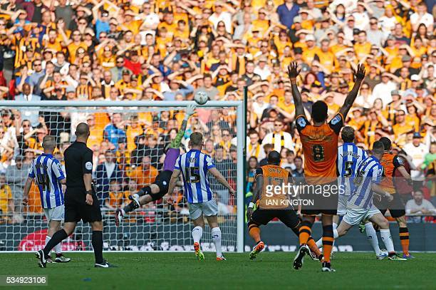 Hull City's Frenchborn Senegalese midfielder Mohamed Diame scores the opening goal during the English Championship playoff final football match...