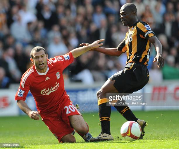 Hull City's George Boateng and Liverpool's Javier Mascherano battle for the ball