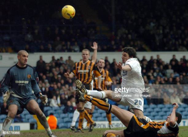 Hull City's goalkeeper Boaz Myhill looks on as Leeds United's Jonathan Douglas shoots high under pressure from Damien Delaney during the CocaCola...