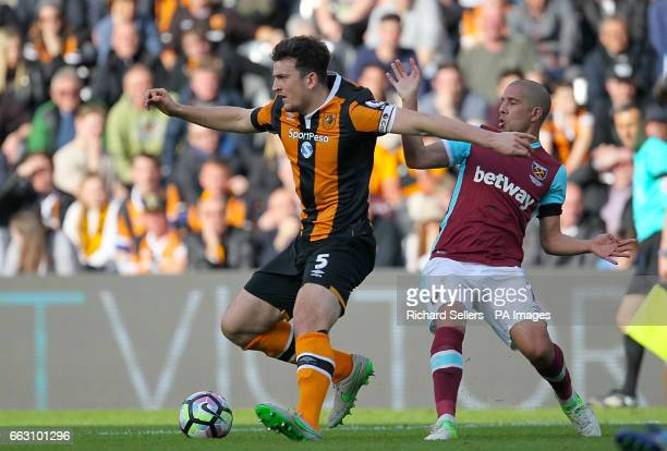 Hull City's Harry Maguire and West Ham United's Sofiane Feghouli battle for the ball during the Premier League match at KCOM Stadium Hull