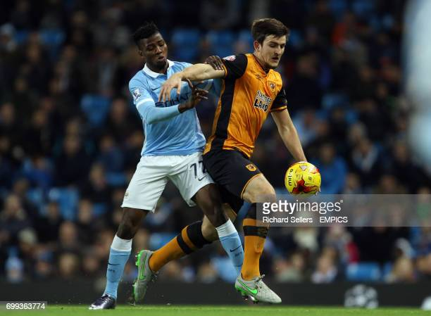 Hull City's Harry Maguire is tackled by Manchester City's Kelechi Iheanacho