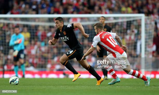 Hull City's Hatem Ben Arfa battles for possession of the ball with Arsenal's Jack Wilshere