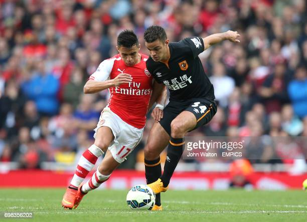 Hull City's Hatem Ben Arfa battles for possession of the ball with Arsenal's Alexis Sanchez