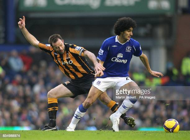 Hull City's Ian Ashbee and Everton's Marouane Fellaini battle for the ball