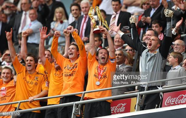 Hull City's Ian Ashbee lifts the Championship play off trophy