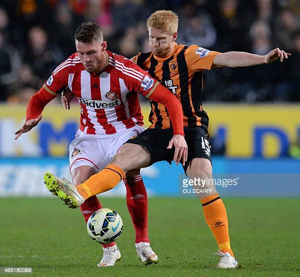 Hull City's Irish defender Paul McShane vies with Sunderland's English striker Conor Wickham during the English Premier League football match between...