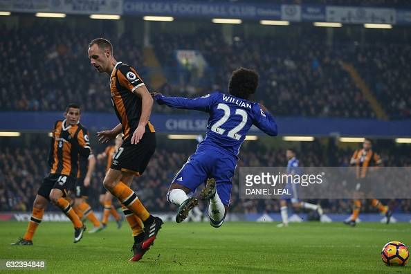 Hull City's Irish midfielder David Meyler fouls Chelsea's Brazilian midfielder Willian during the English Premier League football match between...