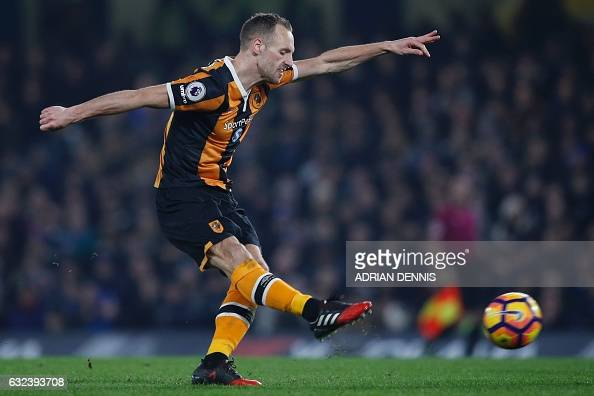 Hull City's Irish midfielder David Meyler has an unsuccessful shot during the English Premier League football match between Chelsea and Hull City at...
