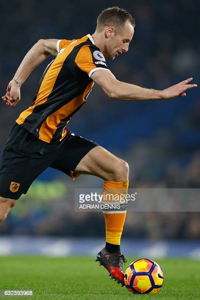Hull City's Irish midfielder David Meyler runs with the ball during the English Premier League football match between Chelsea and Hull City at...