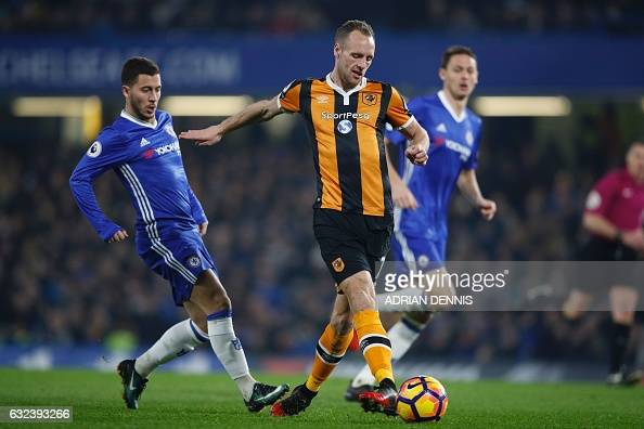 Hull City's Irish midfielder David Meyler vies with Chelsea's Belgian midfielder Eden Hazard during the English Premier League football match between...