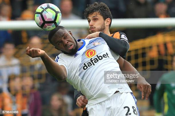 Hull City's Italian defender Andrea Ranocchia vies with Sunderland's Nigerian striker Victor Anichebe during the English Premier League football...