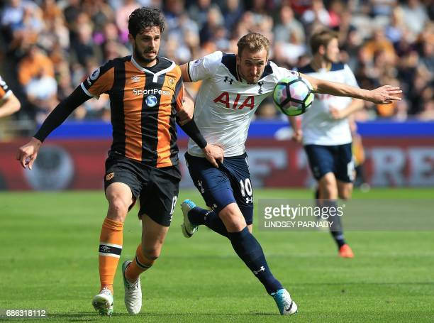 Hull City's Italian defender Andrea Ranocchia vies with Tottenham Hotspur's English striker Harry Kane during the English Premier League football...