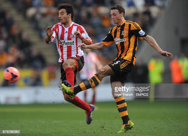 Hull City's James Chester and Sunderland's Ignacio Scocco battle for the ball