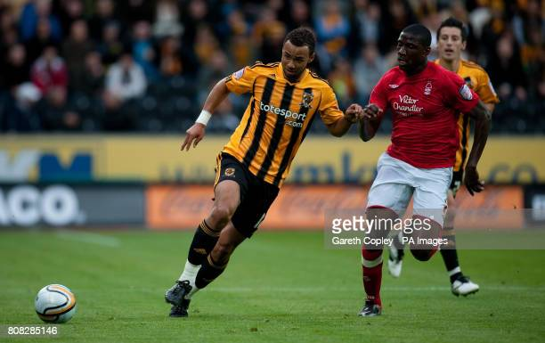 Hull City's John Bostock Nottingham Forest's Guy Moussi during the npower Football League Championship match at the KC Stadium Hull