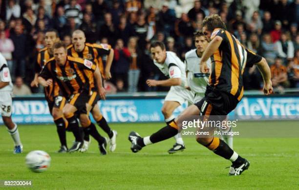 Hull City's Jon Parkin equalises from the penalty spot against Derby County during the CocaCola Championship match at the Kingston Communications...