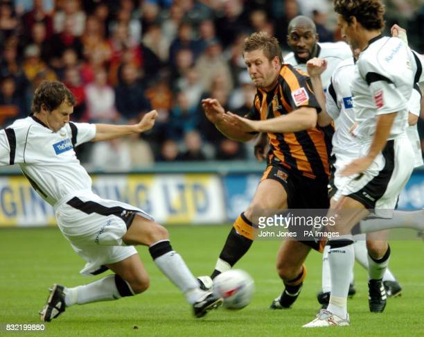 Hull City's Jon Parkin is tackled by Derby Couty's Richard Jackson during the CocaCola Championship match at the Kingston Communications Stadium Hull