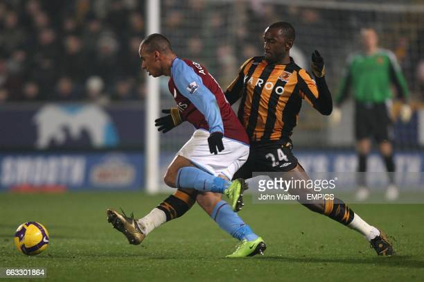 Hull City's Kamil Zayatte and Aston Villa's Gabriel Agbonlahor battle for the ball