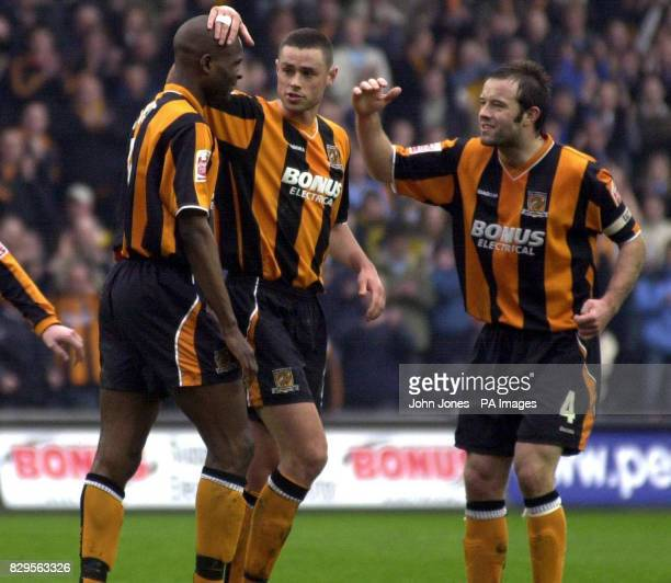 Hull City's Leon Cort is congratulated by teammates Damien Delaney and Ian Ashbee after equalising