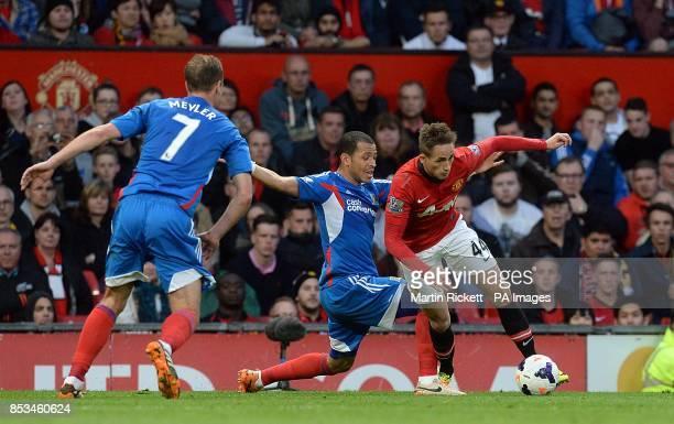 Hull City's Liam Rosenior and Manchester United's Adnan Januzaj battle for the ball
