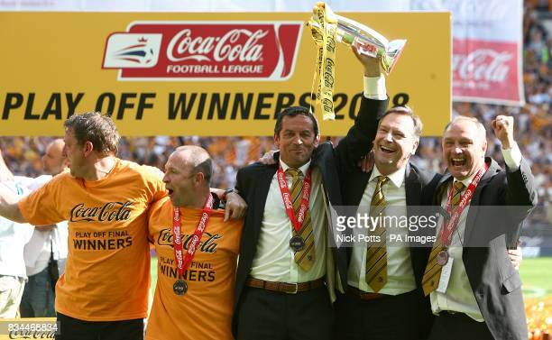 Hull City's manager Phil Brown and his back room staff celebrate winning the Championship play offs