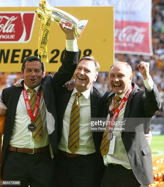 Hull City's manager Phil Brown assistant Brian Horton and Chairman Paul Duffen celebrate winning the Championship play offs