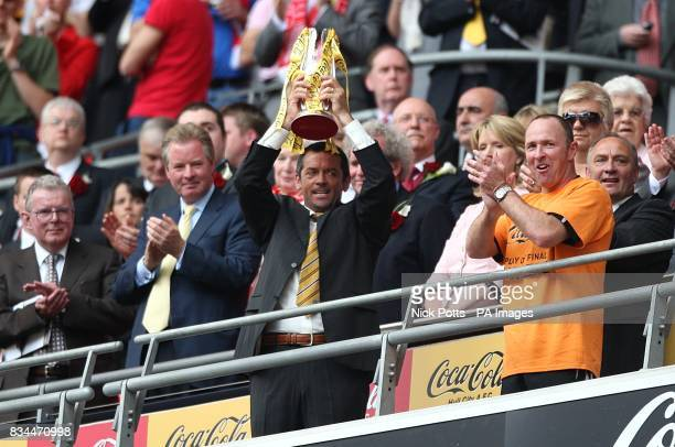 Hull City's manager Phil Brown lifts the Championship play offs trophy