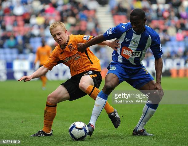 Hull City's Mark Cullen and Wigan Athletic's Maynor Figueroa battle for the ball