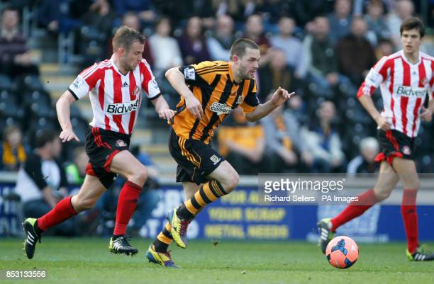 Hull City's Matty Fryatt right and Sunderland's Lee Cattermole in action during the FA Cup Sixth Round match at the KC Stadium Hull