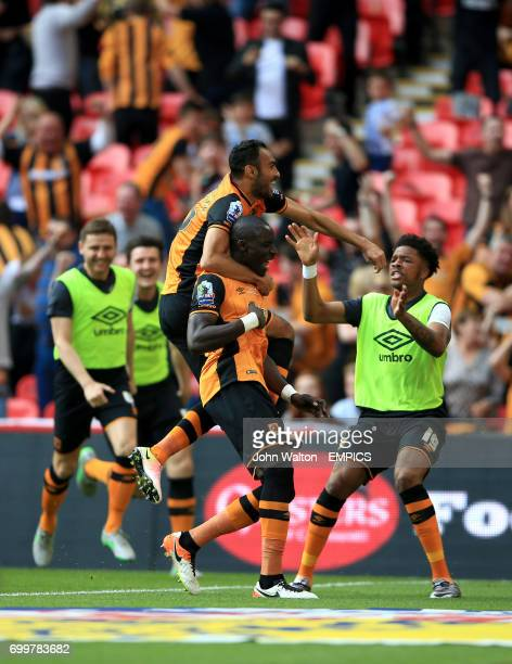 Hull City's Mohamed Diame celebrates scoring his team's opening goal with teammates Ahmed Elmohamady and Chuba Akpom