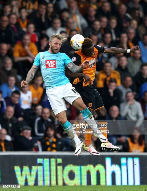 Hull City's Moses Odubajo and Derby County's Johnny Russell battle for the ball in the air