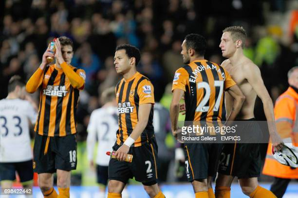 Hull City's Nikica Jelavic Liam Rosenior Ahmed Elmohamady and Michael Dawson trudge off after the defeat