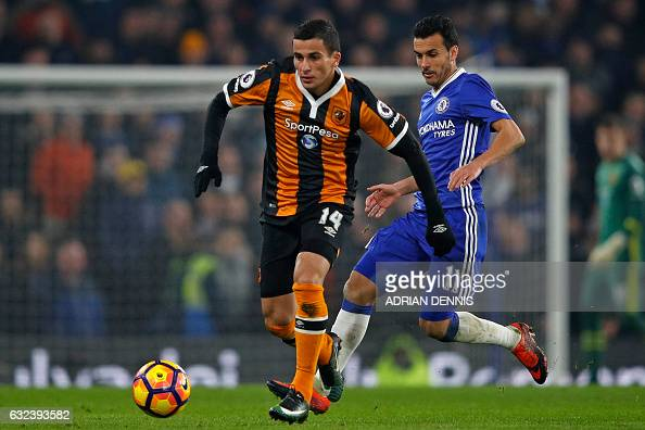 Hull City's Norwegian defender Omar Elabdellaoui vies with Chelsea's Spanish midfielder Pedro during the English Premier League football match...