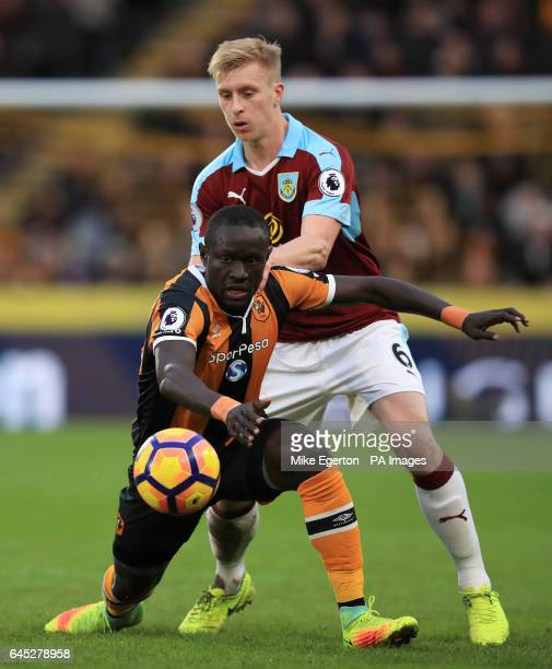 Hull City's Oumar Niasse and Burnley's Ben Mee battle for the ball during the Premier League match at the KCOM Stadium Hull