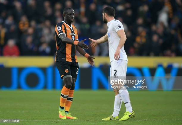 Hull City's Oumar Niasse and Swansea City's Jordi Amat shake hands after the final whistle during the Premier League match at the KCOM Stadium Hull