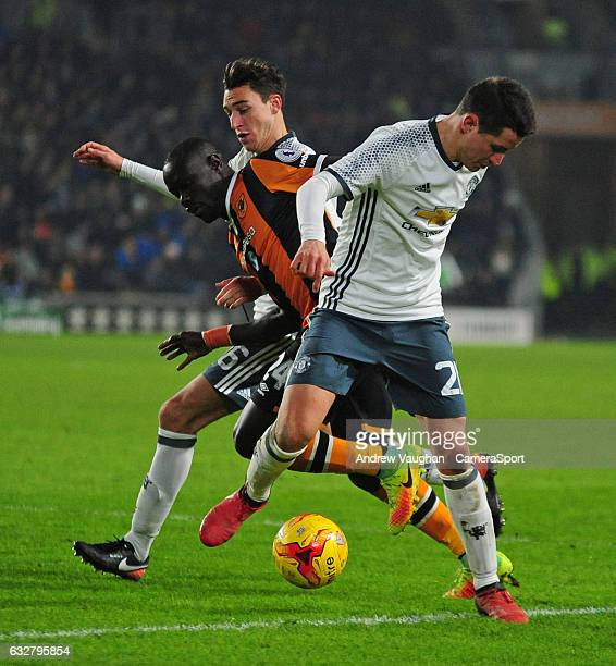 Hull City's Oumar Niasse gets between Manchester United's Ander Herrera right and Matteo Darmian during the EFL Cup SemiFinal Second Leg match...