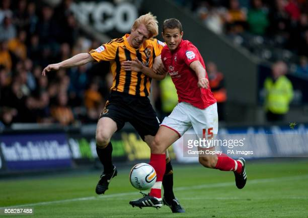Hull City's Paul McShane and Nottingham Forest's Chris Cohen during the npower Football League Championship match at the KC Stadium Hull