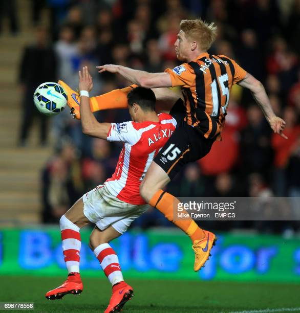 Hull City's Paul McShane battles for the ball with Arsenal's Alexis Sanchez