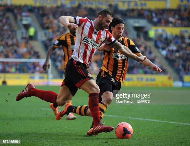 Hull City's Phil Bardsley and Sunderland's George Boyd battle for the ball
