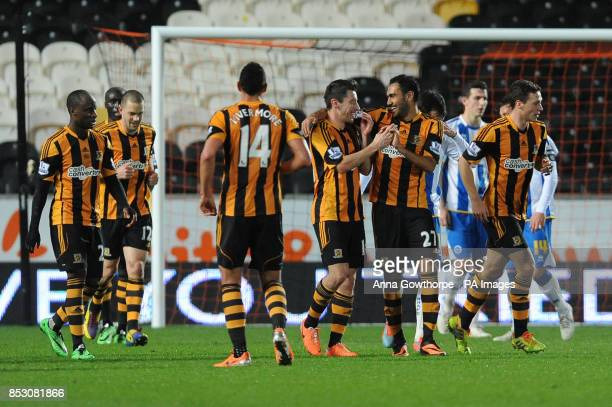Hull City's Robert Koren celebrates with Ahmed Elmohamady after scoring his side's second goal from a free kick during the FA Cup Fifth Round replay...