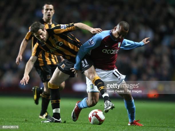 Hull City's Samuel Ricketts and Aston Villa's Gabriel Agbonlahor battle for the ball