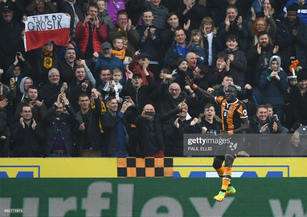 Hull City's Senegalese striker Oumar Niasse celebrates scoring his second goal during the English Premier League football match between Hull City and Swansea City at the KCOM Stadium in Kingston upon Hull, north east England on March 11, 2017. Hull won the game 2-1. / AFP PHOTO / Paul ELLIS / RESTRICTED TO EDITORIAL USE. No use with unauthorized audio, video, data, fixture lists, club/league logos or 'live' services. Online in-match use limited to 75 images, no video emulation. No use in betting, games or single club/league/player publications. /