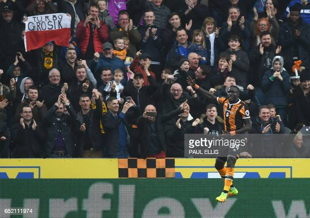 Hull City's Senegalese striker Oumar Niasse celebrates scoring his second goal during the English Premier League football match between Hull City and...