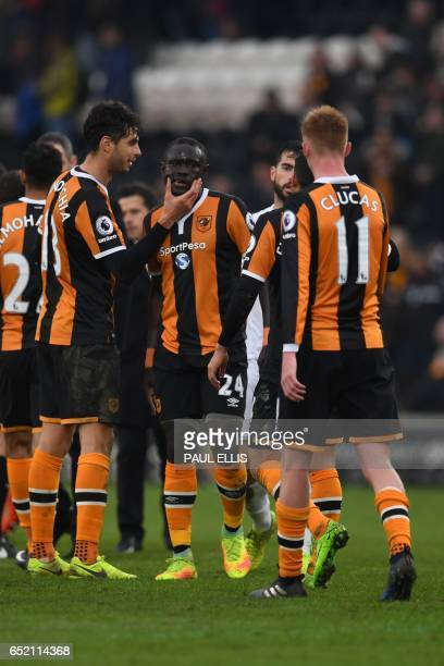 Hull City's Senegalese striker Oumar Niasse celebrates with teammates on the pitch after the English Premier League football match between Hull City...