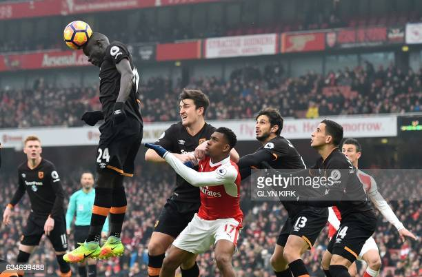 Hull City's Senegalese striker Oumar Niasse heads the ball clear during the English Premier League football match between Arsenal and Hull City at...