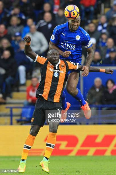 Hull City's Senegalese striker Oumar Niasse vies with Leicester City's Englishborn Jamaican defender Wes Morgan during the English Premier League...